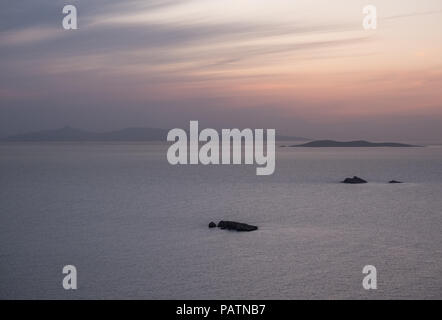Turtle Island in the Sardonic Gulf with Aegina in the background during the evening after the suns set. East Attica, Greece. - Stock Image