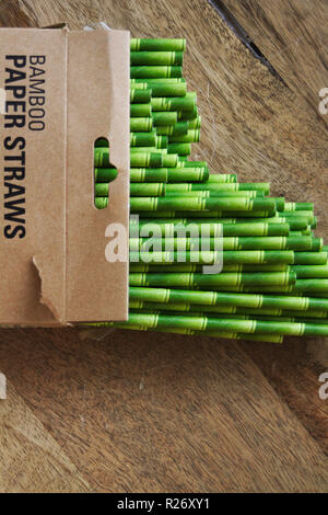 Open packet of paper straws made from bamboo and colored to look like bamboo. - Stock Image