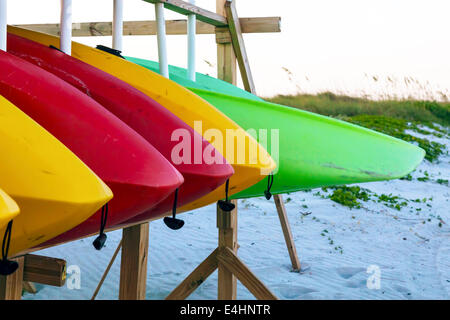 Colorful rental kayaks stored on a rack at a Key Biscayne beach in Miami, Florida, USA. - Stock Image