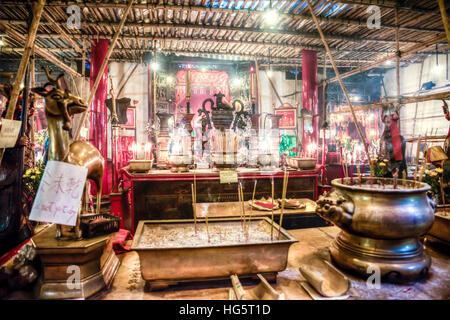 Man Mo Temple on Hong Kong Island iconic incense idols gods prayer altar Hong Kong's only Man Mo Temple, built - Stock Image