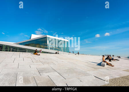 Opera House Oslo, view in summer of people sunbathing along the waterfront concourse of the Oslo Opera House, Norway. - Stock Image