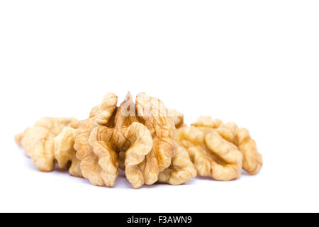 Small group of walnuts on a white background. - Stock Image