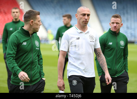 Hampden Park, Glasgow, UK. 14th Apr, 2019. Scottish Cup football, semi final, Aberdeen versus Celtic; Scott Brown leads Callum McGregor and Jonny Hayes of Celtic on pitch inspection Credit: Action Plus Sports/Alamy Live News - Stock Image