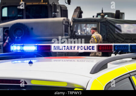 British Military Police Car with blue lights flashing - Stock Image