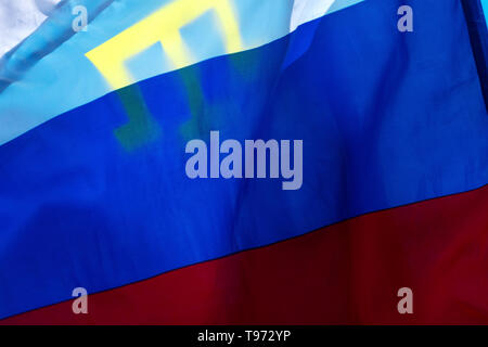 The Russian flag and the flag of the Crimean Tatars in Bakhchisaray, Republic of Crimea - Stock Image