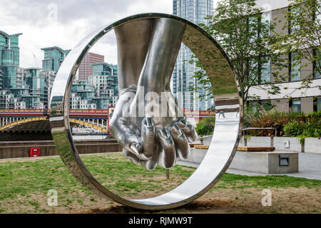 London England United Kingdom Great Britain Westminster Riverside Walk Gardens Love by Lorenzo Quinn sculpture giant hands chrome metal view of Vauxha - Stock Image