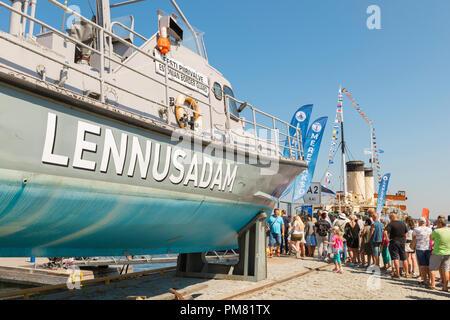 Tallinn Lennusadam, view of Sunday visitors queuing on a summer afternoon to board vintage ships in the Lennusadam Seaplane Harbour, Tallinn, Estonia. - Stock Image