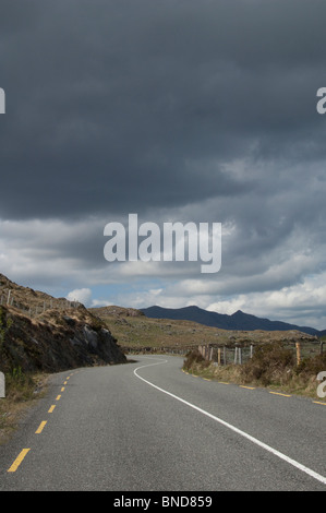 Lonesome Road #41. Remote road through the foothills of mountains - Stock Image