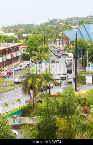 An elevated view of traffic with palm trees and buildings in the capital city of Papeet in Tahiti, French Polynesia. - Stock Image