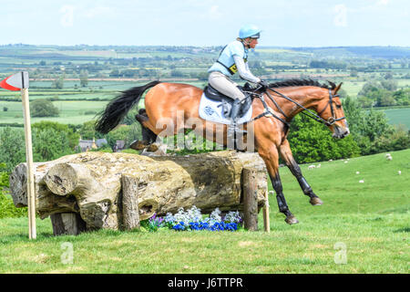 Rockingham Castle, Corby, UK. 21st May, 2017. Izzy Taylor and her horse Perfect Stranger clear a log obstacle with - Stock Image