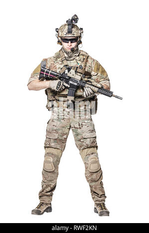 Elite member of U.S. Army rangers in combat uniform with his shirt sleeves rolled up. - Stock Image