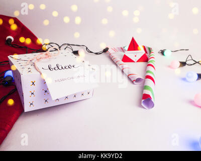 Christmas Decoration with Gifts and Lights with candy cane  and golden color bokeh for background image for invitation - Stock Image