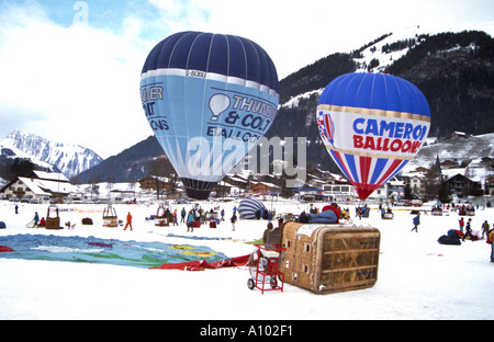 Hot Air Balloons and snow Chateau Doex Switzerland - Stock Image