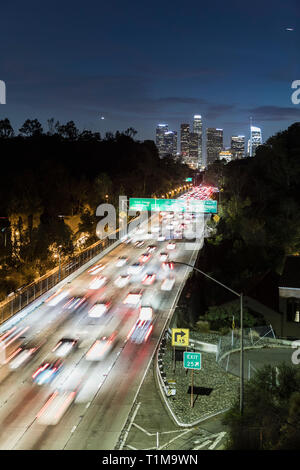 Long exposure cars driving along freeway at night, Los Angeles, California, USA - Stock Image