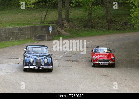 Jaguar Mk2 (1961) and MG MGC Roadster (1968), British Marques Day, 28 April 2019, Brooklands Museum, Weybridge, Surrey, England, Great Britain, UK - Stock Image