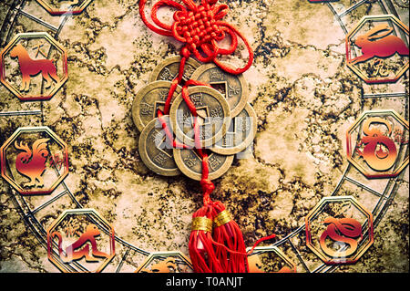 detail of an Chinese astrology wheel and old traditional Feng Shui lucky coins - Stock Image