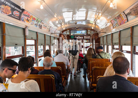 New Orleans streetcar, interior view of the St Charles streetcar showing passengers about to leave, New Orleans, Louisiana, USA. - Stock Image