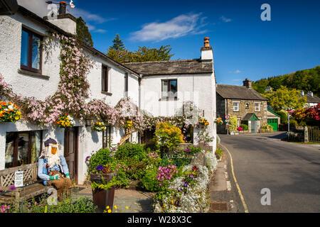 UK, Cumbria, Hawkshead, Near Sawrey, Beatrix Potter's Mr McGregor character figure in garden of Buckle Yeat Guest House - Stock Image