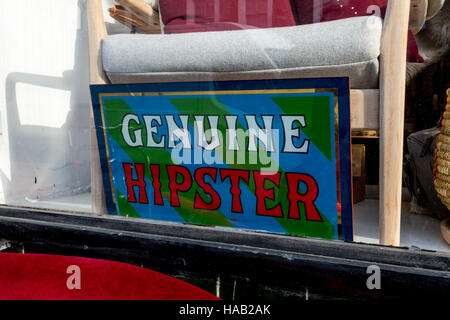 Sign in East London shop window with word Genuine Hipster - Stock Image