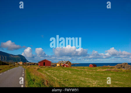 Wooden houses in Hov on the shore of the North Atlantic on island Gimsøy on Lofoten in northern Norway. - Stock Image