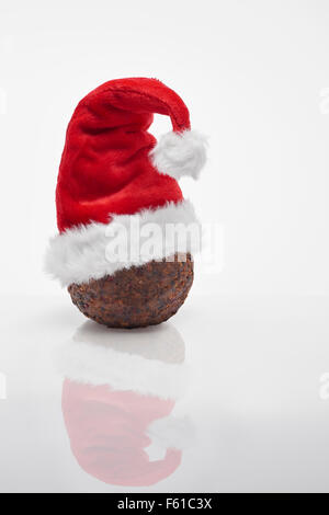 Christmas Pudding with red santa  hat - Stock Image