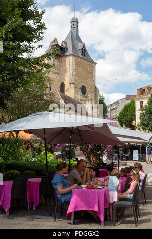 People eating a meal outdoors in a restaurant in Bergerac old town, Bergerac, Dordogne, France Europe - Stock Image