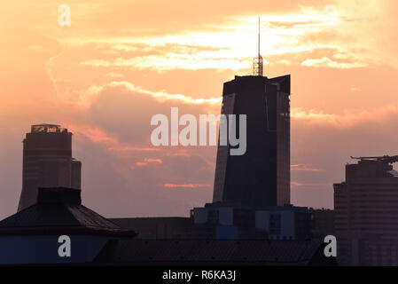 City skyline with high office buildings on dramatic sky. Panorama of Warsaw, Poland. - Stock Image