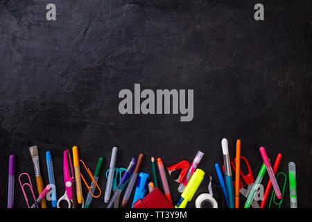 Back to school. Items for the school on a black background - Stock Image