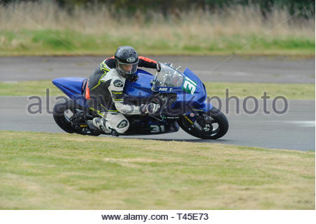 East Fortune, UK. 14 April, 2019. 31 Torquil Paterson on a Suzuki SV650 in a Scottish Lightweights race at East Fortune Raceway, during the opening rounds of the 2019 Scottish Championships, Melville Open and Club Championships. Credit: Roger Gaisford/Alamy Live News - Stock Image