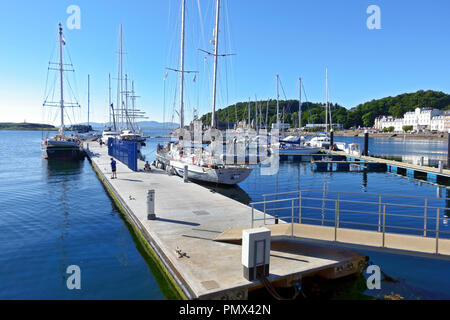Yachts moored at the North Pier pontoons in Oban, Argyll & Bute, Scotland - Stock Image
