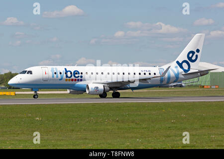 Flybe Embraer ERJ-175 aircraft, registration G-FBJD, taking off at Manchester Airport, England. - Stock Image