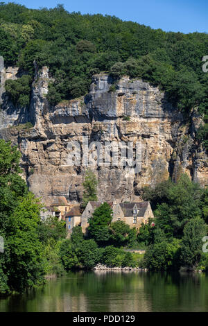 Part of the village of La Roque-Gageac and the Dordogne River. This pictursque village is in the Dordogne department of the Nouvelle-Aquitaine region  - Stock Image