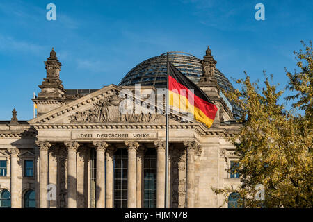 German National Flag in front of Reichstag, Berlin - Stock Image