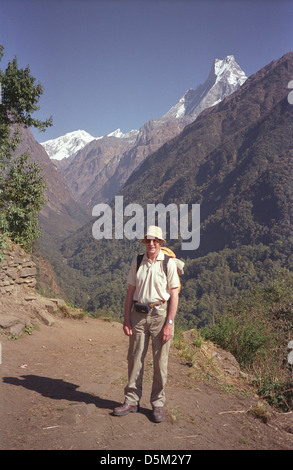 Trekker David Keith Jones near Chomrong on Annapurna circuit with peaks of range Gangapurna Annapurna II and Machhapuchhre - Stock Image