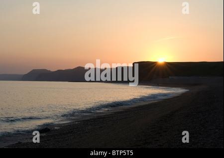 Burton Bradstock beach at dusk, Dorset, UK. - Stock Image