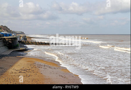 A view of the west beach and promenade in winter at the North Norfolk seaside resort of Cromer, Norfolk, England, United Kingdom, Europe. - Stock Image