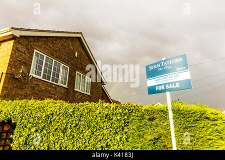 For sale board with rainbow above, For sale sign with rainbow above, housing market recovery, housing market, sign, board, rainbow, house, metaphor, - Stock Image