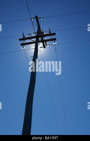 Silhouetted power pole - Stock Image