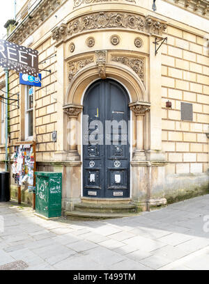 Graffiti on doors at the entrance to a disused TSB bank in Frome Somerset UK - Stock Image