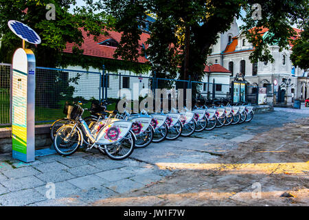 Bicycles in a row prepared for rent near the square in Pszczyna, Poland. - Stock Image