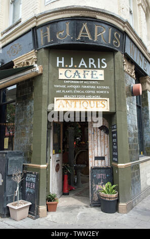 H. J. ARIS, entrance to trendy cafe and antiques shop, Dalston, London Borough of Hackney. - Stock Image