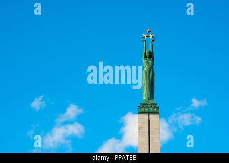 Riga Freedom Monument, view of the Liberty statue sited on top of the column rising from the Freedom Monument (1935) in the centre of Riga, Latvia. - Stock Image