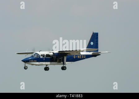 British Police Pilatus Britten-Norman Ltd BN2B-20 Islander plane flying at the Royal International Air Tattoo, Cotswolds, UK. G-NESU. Space for copy - Stock Image