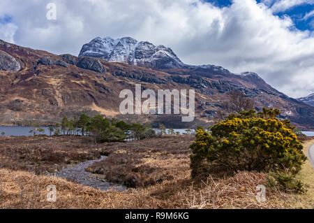 Loch Maree in Wester Ross Highland Scotland UK with snow covered mountain Slioch behind - Stock Image