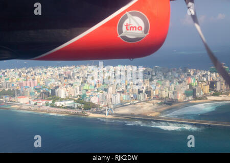 Maldives travel - Male city and island seen from a Trans Maldivian Airways seaplane, the Maldives, Asia - Stock Image