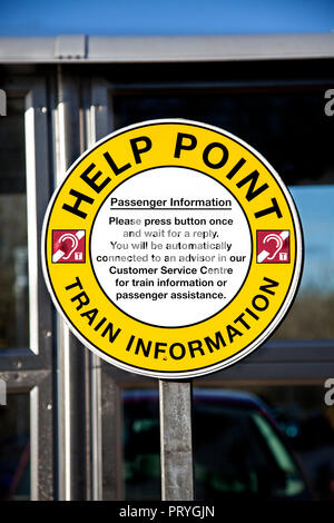 Sign above a help point at an unmanned railway station in Scoltand, UK, with a symbol indicating hearing loop access for hearing-impaired customers. - Stock Image