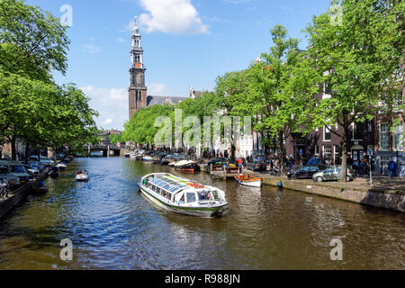 Tourist cruise boat on Prinsengracht canal in Amsterdam, Netherlands - Stock Image