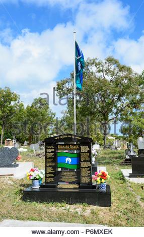 Grave of Bernard Namok, designer of the Torres Strait flag, in the Heritage-listed Thursday Island cemetery, Torres Strait Islands, Far North Queensla - Stock Image