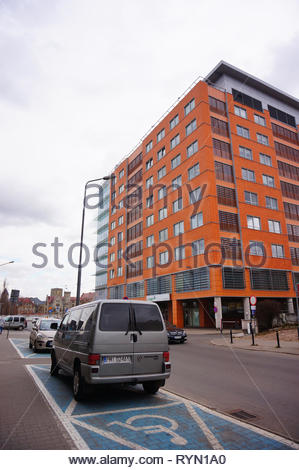 Poznan, Poland - March 8, 2019: Parked Volkswagen Transporter on a disability parking near the Globis office building. - Stock Image