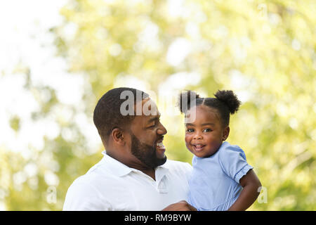 African American father holding his little girl. - Stock Image
